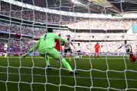England's Jesse Lingard, 2nd right, scores the opening goal during the World Cup 2022 group I qualifying soccer match between England and Andorra at Wembley stadium in London, Sunday, Sept. 5, 2021. (AP Photo/Ian Walton)