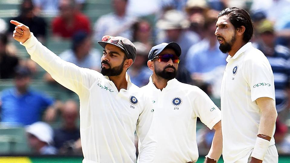 India's captain Virat Kohli (pictured left) talks to teammates Mohammed Shami (pictured middle) and Ishant Sharma (pictured right).