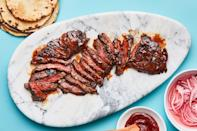 """Skirt steak is the ultimate summer steak for grilling—quick cooking, buttery, and versatile. <a href=""""https://www.bonappetit.com/recipe/gochujang-marinated-skirt-steak?mbid=synd_yahoo_rss"""" rel=""""nofollow noopener"""" target=""""_blank"""" data-ylk=""""slk:See recipe."""" class=""""link rapid-noclick-resp"""">See recipe.</a>"""