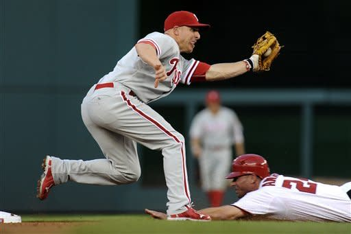Philadelphia Phillies' second baseman Pete Orr takes the throw from catcher Carlos Ruiz just before he applies the tag on Washington Nationals' Rick Ankiel, who attempted to steal second, during the second inning of their baseball game at Nationals Park, Friday, May 4, 2012, in Washington. (AP Photo/Richard Lipski)