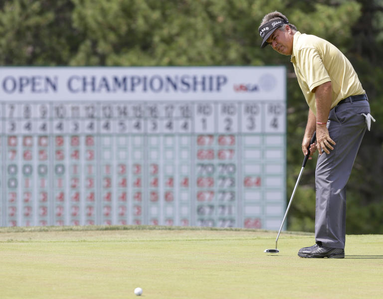 Kenny Perry reacts as follows a putt on the 18th hole Saturday, July 13, 2013, in the third round of the U.S. Senior Open golf tournament in Omaha, Neb. (AP Photo/Nati Harnik)
