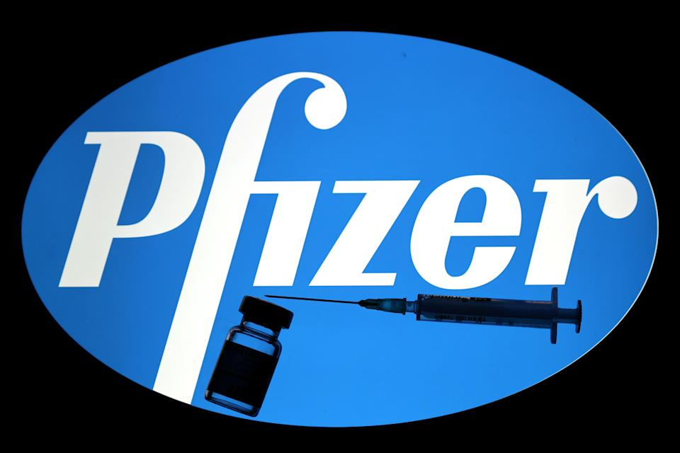 ANKARA, TURKEY - DECEMBER 16: In this photo illustration taken in Ankara, Turkey on December 16, 2020 Pfizer logo is displayed on a screen with a syringe and medical bottle in the front. (Photo by Mehmet Kaman/Anadolu Agency via Getty Images)