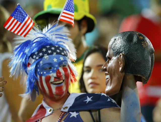 A U.S. fan poses at half time at the 2014 World Cup Group G soccer match between Ghana and the USA at the Dunas arena in Natal June 16, 2014. REUTERS/Brian Snyder (BRAZIL - Tags: SOCCER SPORT WORLD CUP) TOPCUP