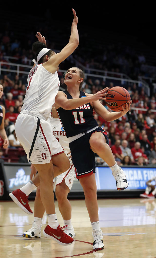 Gonzaga guard Laura Stockton (11) is fouled by Stanford forward Kaylee Johnson, left, during the first half of a first-round game in the NCAA women's college basketball tournament in Stanford, Calif., Saturday, March 17, 2018. (AP Photo/Tony Avelar)