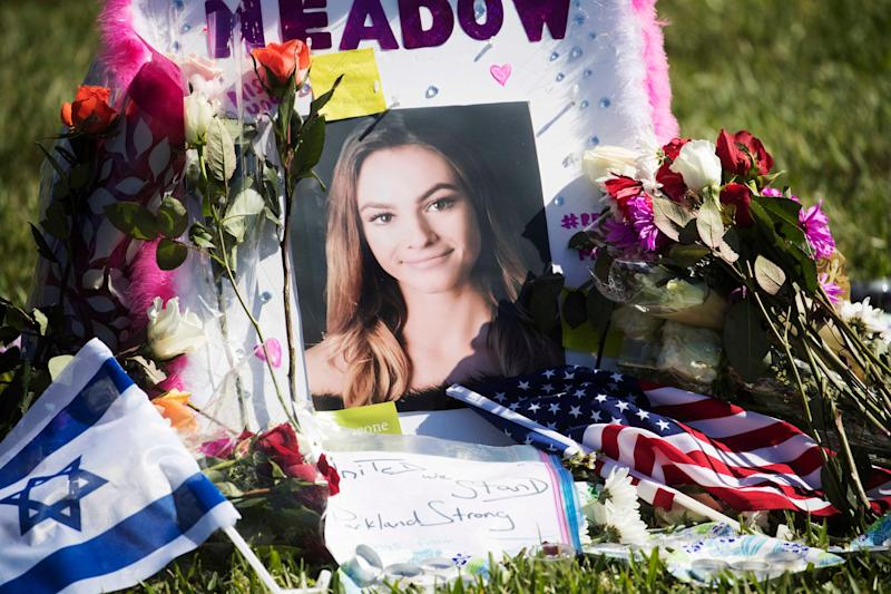 A photo of Meadow Pollack,19, was set up at one of the crosses that has been erected at the Parkland, Florida, amphitheatre in February 2018.