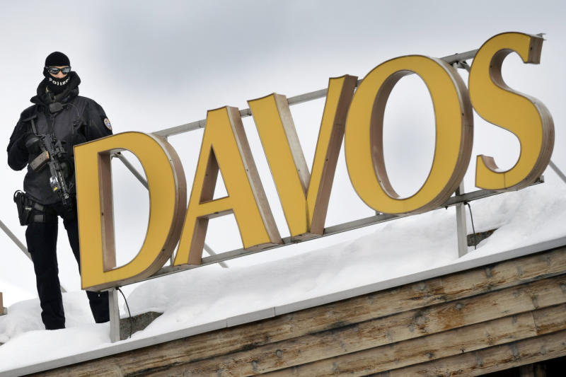 """A member of Swiss special police forces stands on the roof of the Kongress Hotel next to the Congress Center, on the eve of the opening of the 43rd Annual Meeting of the World Economic Forum, WEF, in Davos, Switzerland, Tuesday, Jan. 22, 2013. The overarching theme of the meeting, which will take place from 23 to 27 January, is """"Resilient Dynamism"""". (AP Photo/Keystone, Laurent Gillieron)"""