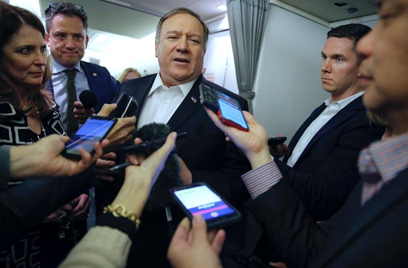 Pompeo talks to journalists on his plane as he flies to Kuwait (AFP Photo/JIM YOUNG)