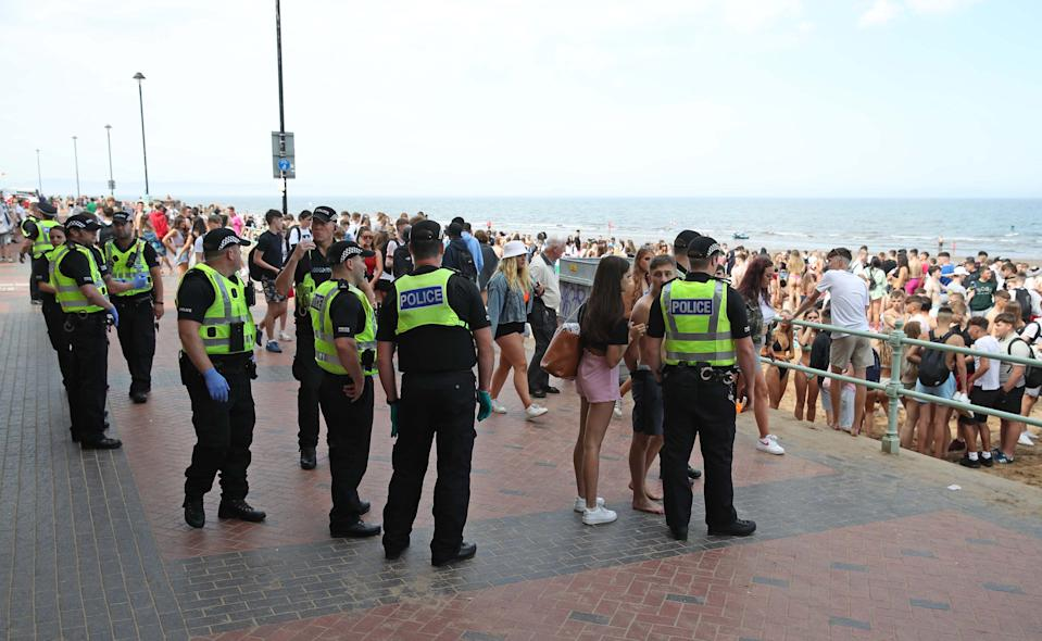 Police at Portobello Beach in Edinburgh where they broke up large crowds who flocked to the beach to make the most of the good weather. (Photo by Andrew Milligan/PA Images via Getty Images)
