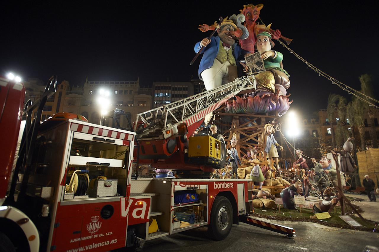 VALENCIA, SPAIN - MARCH 19:  People prepare for the burning of the 'Ninot' caricatures during the last day of the 'Fallas' festival on March 19, 2012 in Valencia, Spain. The festival, which runs March 15 - 19, celebrates the arrival of spring with fireworks, fiestas and bonfires. (Photo by Xaume Olleros/Getty Images)