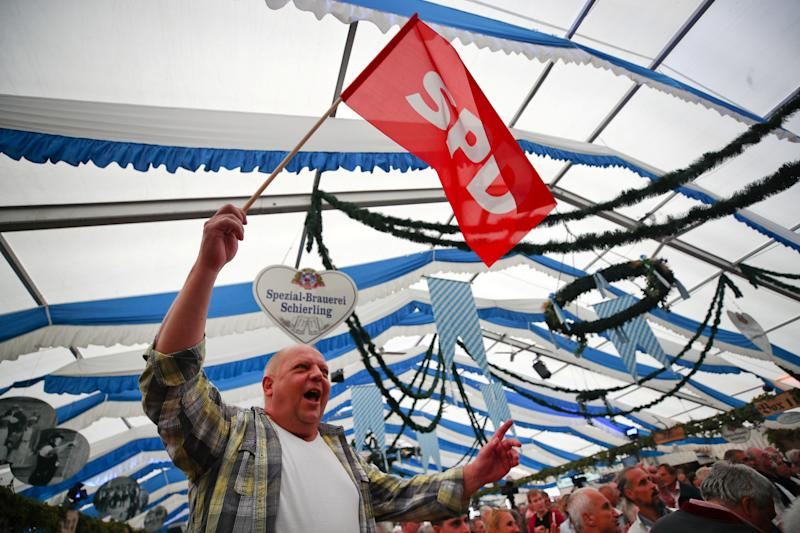 A supporter of Germany's Social Democratic Party's (SPD) waves a flag at one of Bavaria's oldest fairs, the Gillamoos Fair in Abensberg, Germany September 2, 2019. REUTERS/Michael Dalder