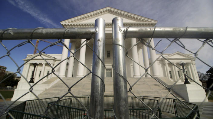 The Virginia state Capitol building is surrounded by fencing