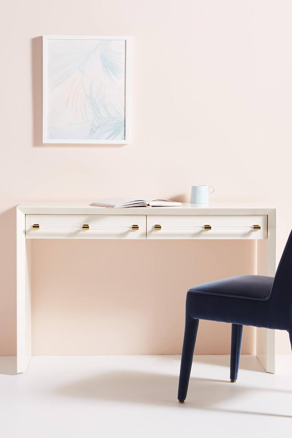 """<h3>Anthropologie Merriton Desk</h3><br>It doesn't get much sleeker than this chamfered-edge wooden desk with an unencumbered frame, streamlined storage drawers, and gleaming brass accents.<br><br><strong>Anthropologie</strong> Merriton Desk, $, available at <a href=""""https://go.skimresources.com/?id=30283X879131&url=https%3A%2F%2Fwww.anthropologie.com%2Fshop%2Fmerriton-desk"""" rel=""""nofollow noopener"""" target=""""_blank"""" data-ylk=""""slk:Anthropologie"""" class=""""link rapid-noclick-resp"""">Anthropologie</a>"""