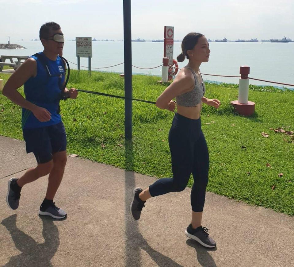 Andre Cherbonnier (left) running blindfolded with a guide runner during his training for the Standard Chartered Singapore Marathon 2018. (PHOTO: Andre Cherbonnier)