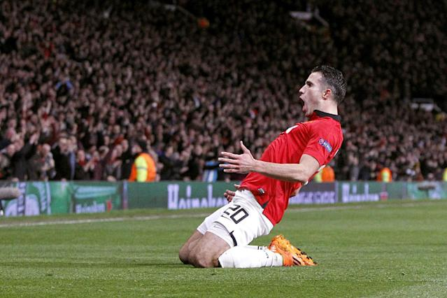 Manchester United's Robin van Persie celebrates scoring his side's third goal and his hat-trick, during the Champions League, Round of 16, second leg match against Olympiakos, at Old Trafford, Manchester, England, Wednesday March 19, 2014. (AP Photo /PA, Peter Byrne)