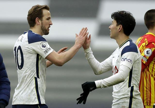 Goalscorers Harry Kane, left, and Son Heung-min celebrate after the game