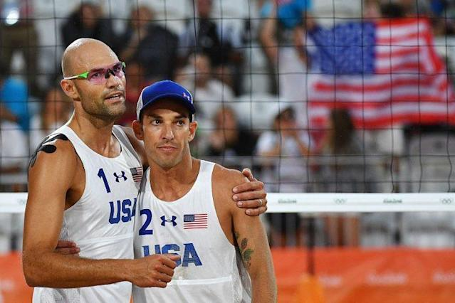 "<a class=""link rapid-noclick-resp"" href=""/olympics/rio-2016/a/1105749/"" data-ylk=""slk:Phil Dalhausser"">Phil Dalhausser</a> (L) and <a class=""link rapid-noclick-resp"" href=""/olympics/rio-2016/a/1105815/"" data-ylk=""slk:Nicholas Lucena"">Nicholas Lucena</a> celebrate after winning the men's beach volleyball qualifying match between the USA and Tunisia at the Beach Volley Arena in Rio de Janeiro.  (AFP/Getty Images)"