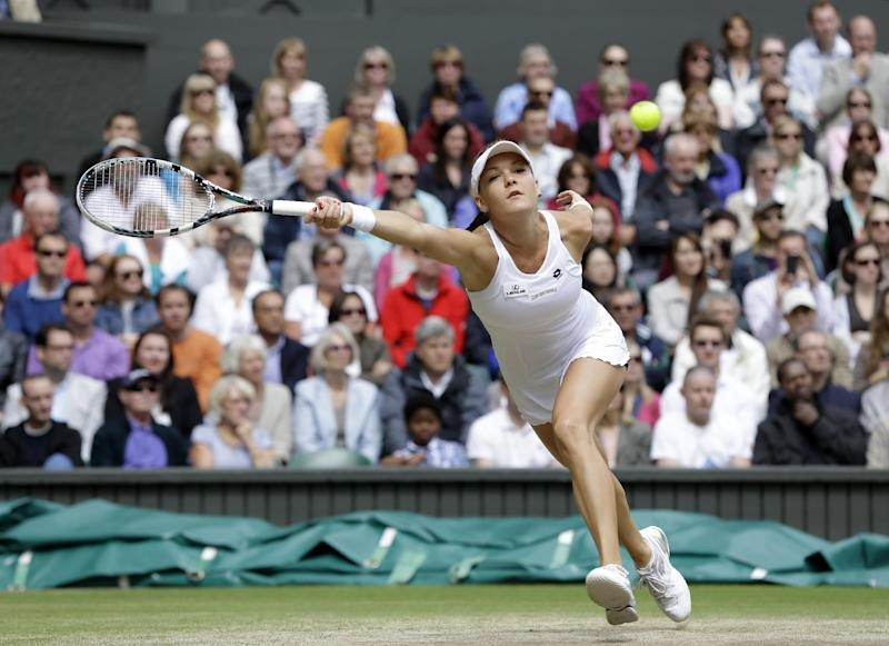 Agnieszka Radwanska of Poland plays a shot to Serena Williams of the United States during the women's final match at the All England Lawn Tennis Championships at Wimbledon, England, Saturday, July 7, 2012. (AP Photo/Alastair Grant)