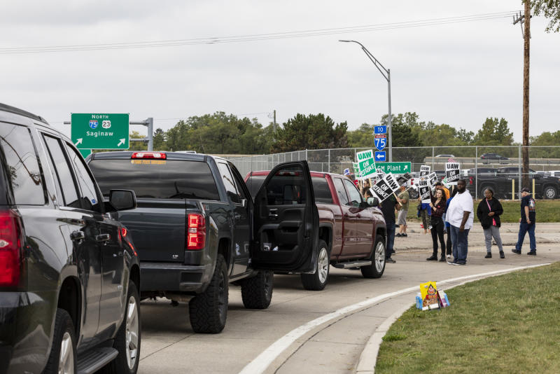 Protesting union members prevent cars from driving into the General Motors Flint Assembly Plant on Bristol Road as United Automobile Workers remain on strike against GM on Tuesday, Sept. 17, 2019, in Flint, Mich. GM and the union are faced with weakening vehicle sales, a deteriorating global economy and an unpredictable trade war.  (Sara Faraj/MLive.com/The Flint Journal via AP)