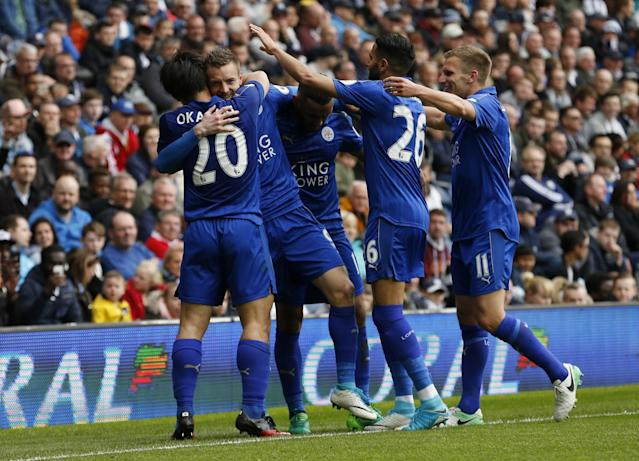 <p>Leicester City's Jamie Vardy celebrates scoring their first goal with teammates </p>