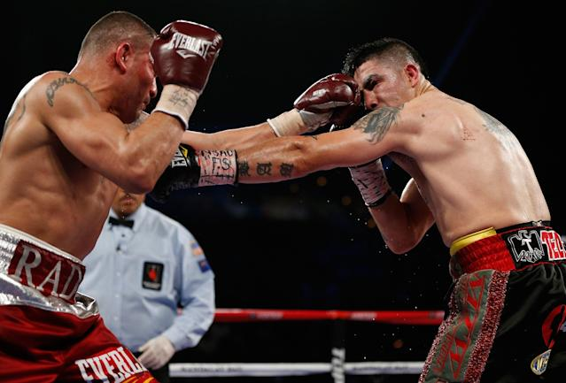 LAS VEGAS, NV - MARCH 30: (R-L) Brandon Rios and Mike Alvarado trade punches in their WBO interim junior welterweight championship bout at the Mandalay Bay Events Center on March 30, 2013 in Las Vegas, Nevada. (Photo by Josh Hedges/Getty Images)