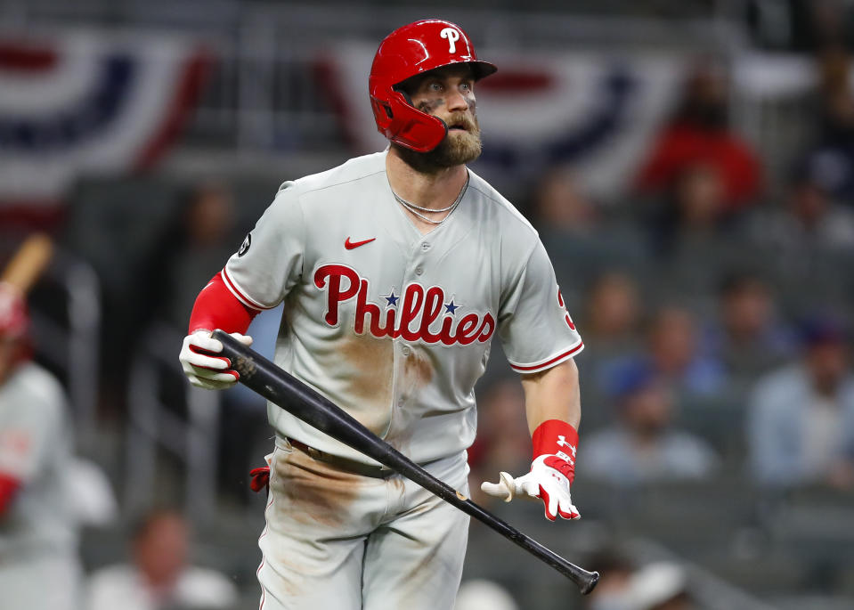 ATLANTA, GA - APRIL 10: Bryce Harper #3 of the Philadelphia Phillies hits a home run in the sixth inning of an MLB game against the Atlanta Braves at Truist Park on April 10, 2021 in Atlanta, Georgia. (Photo by Todd Kirkland/Getty Images)