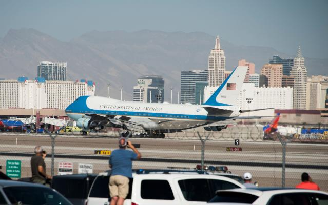 <p>President Donald Trump and First Lady Melania Trump land on Air Force 1 at McCarran International Airport in Las Vegas, Nev., to meet survivors and first responders following the worst mass shooting in modern American history, Oct. 4, 2017. (Photo: Robyn Beck/AFP/Getty Images) </p>