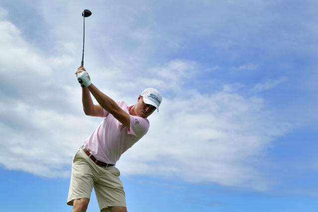 Justin Thomas hits from the first tee during the Tournament of Champions pro-am golf event, Wednesday, Jan. 1, 2020, at Kapalua Plantation Course in Kapalua, Hawaii. (AP Photo/Matt York)
