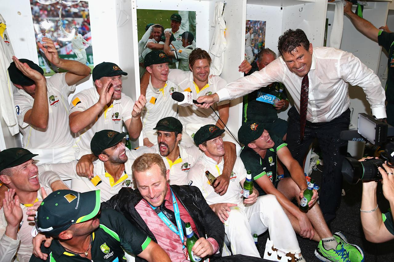 PERTH, AUSTRALIA - DECEMBER 17:  Former Australian Captain Mark Taylor interviews the Australian Team as they celebrate victory in the change rooms during day five of the Third Ashes Test Match between Australia and England at WACA on December 17, 2013 in Perth, Australia.  (Photo by Ryan Pierse/Getty Images)