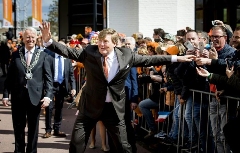 Dutch King Willem-Alexander gestures as he celebrates his 50th birthday on the traditional King's Day (Koningsdag) in the southern city of Tilburg