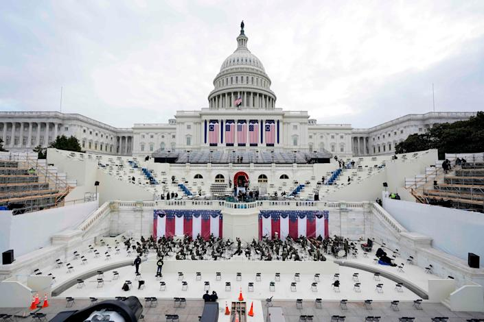 The U.S. Capitol is adorned with flags ahead of Wednesday's inaugural ceremony.