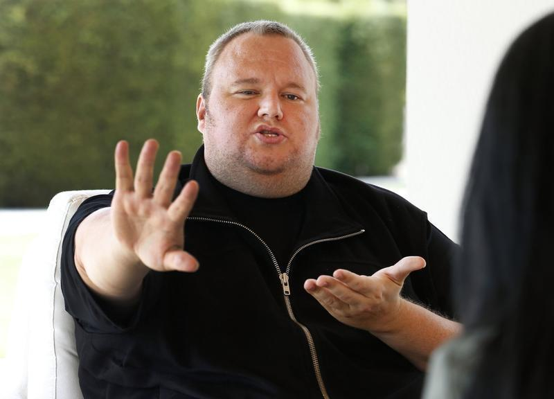 Kim Dotcom gestures as he speaks during an interview with Reuters in Auckland