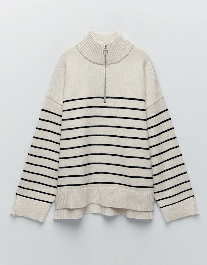 "If you like your sweaters on the baggy side, you'll want to scoop up this striped piece with slit cuffs and a high-low hem. $49.9, Zara. <a href=""https://www.zara.com/us/en/striped-knit-sweater-p05536025.html"" rel=""nofollow noopener"" target=""_blank"" data-ylk=""slk:Get it now!"" class=""link rapid-noclick-resp"">Get it now!</a>"