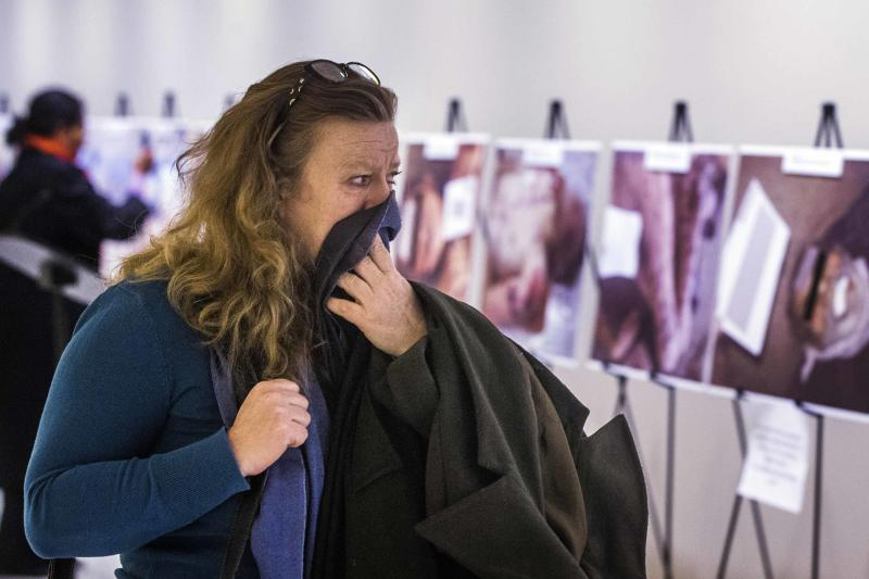 "A woman reacts as she looks at a gruesome collection of images of dead bodies taken by a photographer, who has been identified by the code name ""Caesar,"" at the United Nations Headquarters in New York, March 10, 2015. The pictures were smuggled out of Syria between 2011 and mid-2013. The exhibition at the UN consists of two dozen images selected from the roughly 55,000 photographs taken in Syria by a former military police photographer - some showing eye gougings, strangulation and long-term starvation - as the conflict in Syria enters its fifth year. REUTERS/Lucas Jackson (UNITED STATES - Tags: POLITICS CIVIL UNREST CONFLICT TPX IMAGES OF THE DAY)"