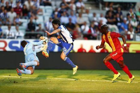 Rio Ave's goalkeeper Cassio tries to catch the ball as IFK Goteborg's Vibe tries to score during their Europa League qualifying round match in Gothenburg