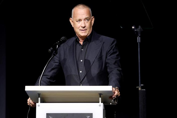 <p>Tom Hanks mans the podium on Sept. 21 at the opening of the Academy Museum of Motion Pictures in Los Angeles. </p>