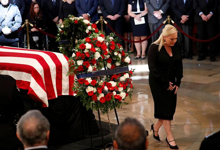 Meghan McCain, daughter of the late senator, cries as she turns from her father's casket.