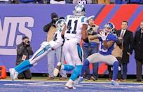 Dec 20, 2015; East Rutherford, NJ, USA; New York Giants wide receiver Odell Beckham (13) catches a touchdown pass against Carolina Panthers cornerback Josh Norman (24) with less than 2 minutes to play to tie the sore at MetLife Stadium. Mandatory Credit: Jim O'Connor-USA TODAY Sports
