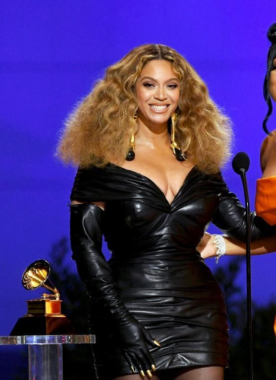Beyonce wore a leather mini dress for her history-making night at the Grammys