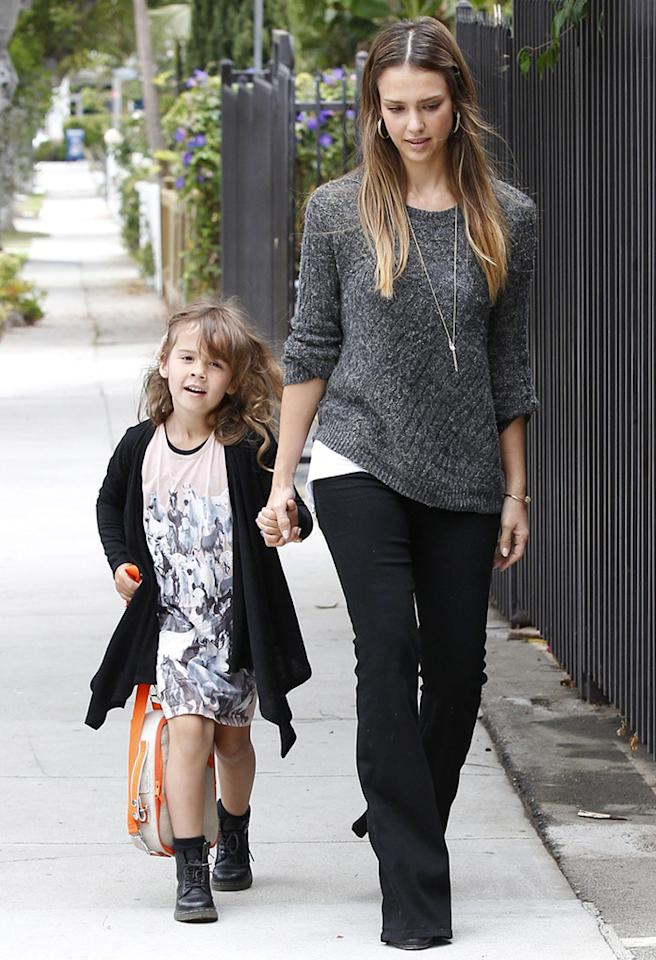 Jessica Alba strolled along with her mini-me, otherwise known as her 5-year-old daughter, Honor, on their way to school in Santa Monica, California, on Monday. (6/24/2013)