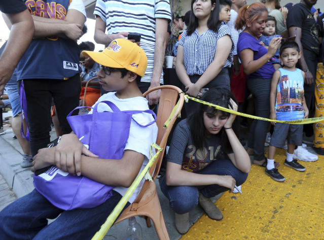 Dejected fans await LeBron James' arrival at Blaze Pizza in Culver City, California. (AP)