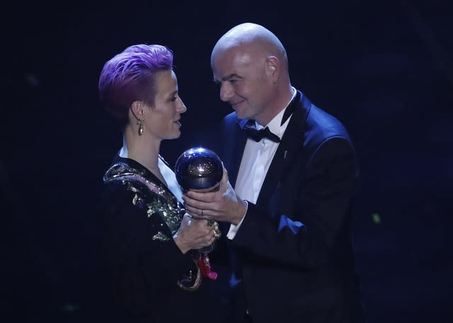 Megan Rapinoe receives the Best FIFA Women's player award from FIFA president Gianni Infantino (Antonio Calanni/AP)