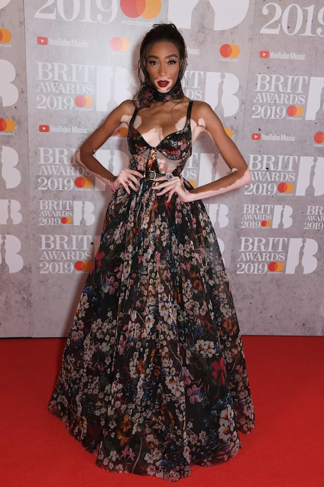 <p>Model Winnie Harlow showed the music industry how it's done on the red carpet in a sheer floral dress and matching headscarf. <em>[Photo: Getty]</em> </p>