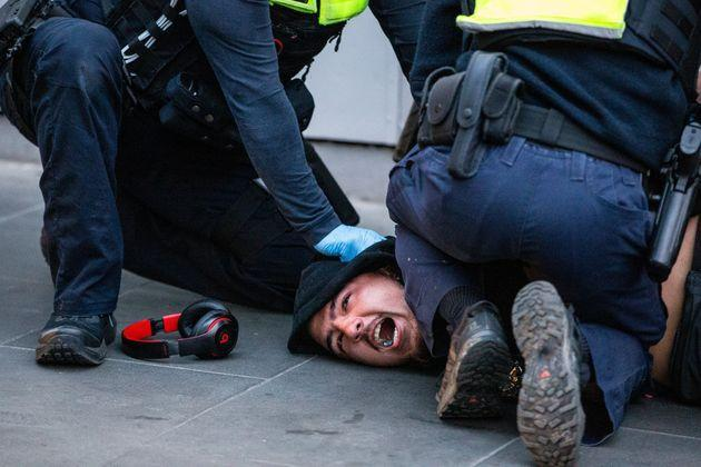 Victoria police arrest a protester during an anti vaccine protest on September 21, 2021 (Photo: Diego Fedele via Getty Images)