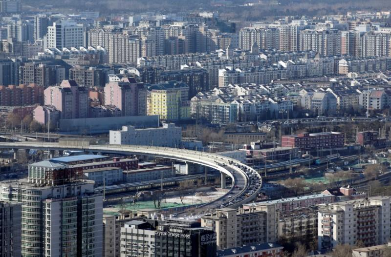China's home price growth at almost 1-1/2-year low, further softening seen