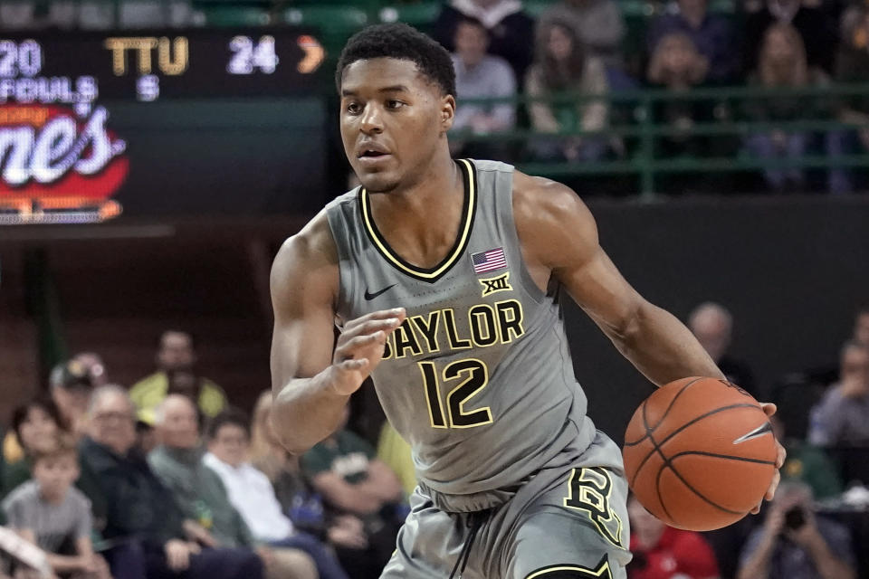 FILE - Baylor's Jared Butler (12) drives against Texas Tech during the first half of an NCAA college basketball game in Waco, Texas, in this Monday, March 2, 2020, file photo. Baylor will begin the college basketball season at No. 2 in the preseason AP Top 25 poll released Monday, Nov. 9, 2020. (AP Photo/Chuck Burton, File)