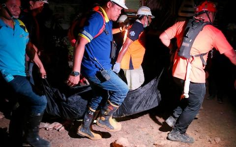 Rescue attempts have been limited by ongoing rains and fears of new landslides in the Naga City area - Credit: Bullit Marquez/AP
