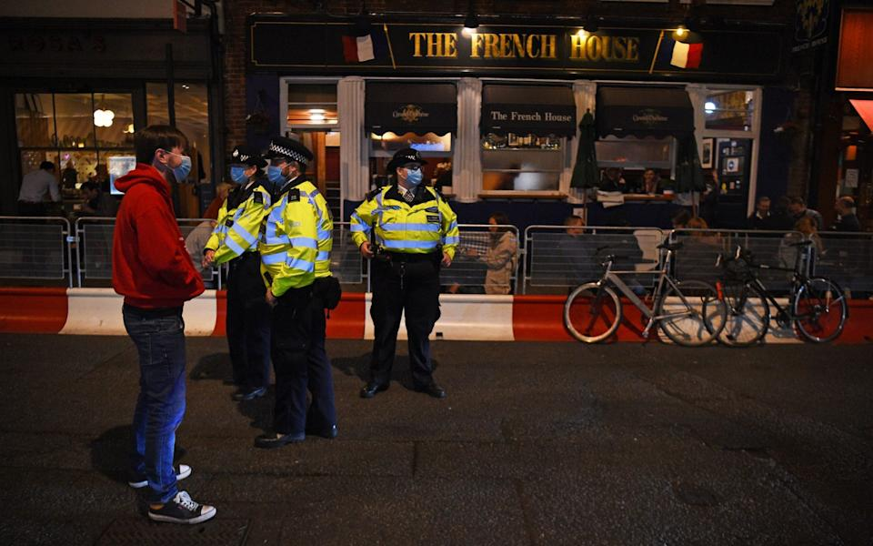 Police have the unenviable task of dispersing revellers once the curfew hits - Kirsty O'Connor/PA
