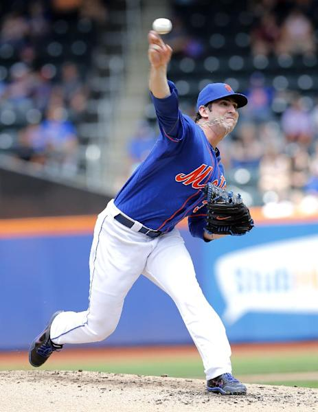 File-This June 8, 2013 file photo shows New York Mets starting pitcher Matt Harvey throwing a pitch in the first inning of a baseball game against the Miami Marlins at Citi Field in New York. (AP Photo/Paul J. Bereswill, File)