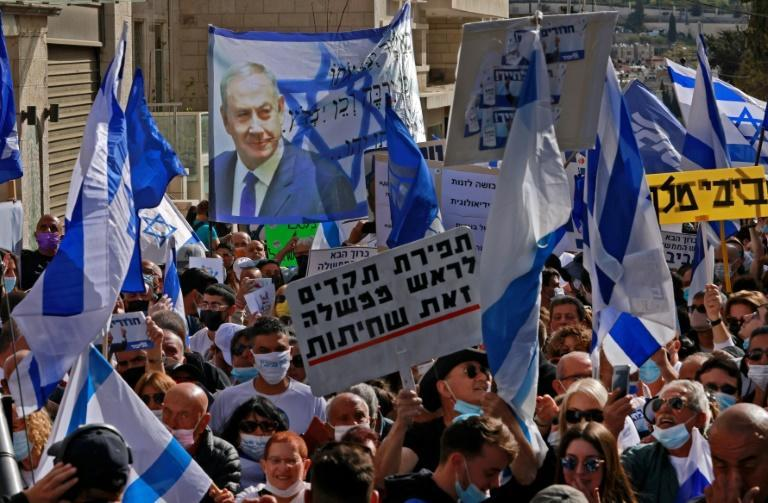 Supporters of Prime Minister Benjamin Netanyahu gather outside the district court in Jerusalem ahead of his corruption trial