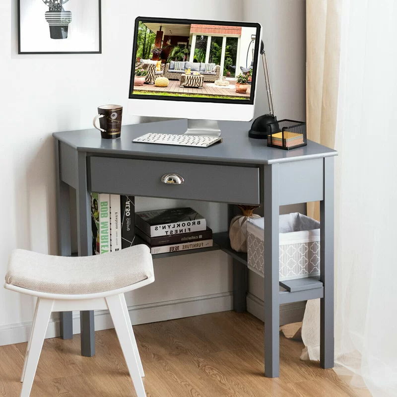 """<h2>45% Off Gracie Oaks Corner Desk</h2><br><strong>96 reviews and 4.4 out of 5 stars</strong><br>""""Fits the space perfectly. We needed a desk that took up as little space as possible and this is the perfect solution. Love that there are shelves along the bottom in order to add computer hardware and external devices and still have enough space for sitting. The quality and look are great. Even has a drawer to add work clutter."""" <em>– Wayfair Reviewer</em><br><br><em>Shop <strong><a href=""""https://www.wayfair.com/furniture/pdp/gracie-oaks-corner-desk-w000495637.html"""" rel=""""nofollow noopener"""" target=""""_blank"""" data-ylk=""""slk:Wayfair"""" class=""""link rapid-noclick-resp"""">Wayfair</a></strong></em><br><br><strong>Gracie Oaks</strong> Corner Desk, $, available at <a href=""""https://go.skimresources.com/?id=30283X879131&url=https%3A%2F%2Fwww.wayfair.com%2Ffurniture%2Fpdp%2Fgracie-oaks-corner-desk-w000495637.html"""" rel=""""nofollow noopener"""" target=""""_blank"""" data-ylk=""""slk:Wayfair"""" class=""""link rapid-noclick-resp"""">Wayfair</a>"""